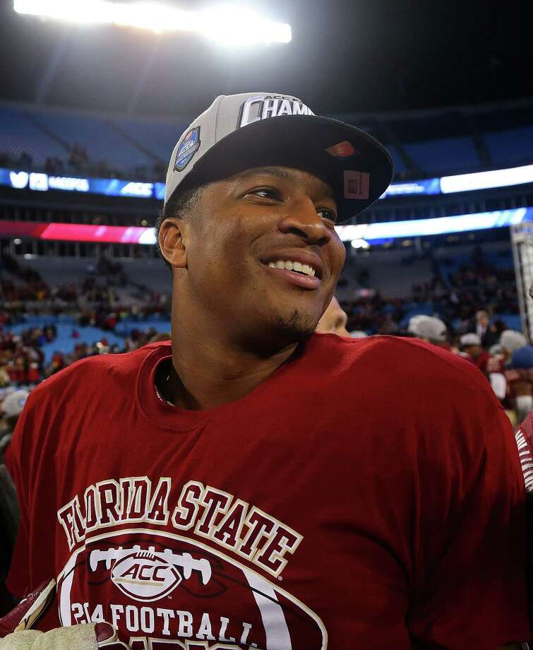 CHARLOTTE, NC - DECEMBER 06:  Jameis Winston #5 of the Florida State Seminoles celebrates after their 37-35 victory over the Georgia Tech Yellow Jackets at the ACC Championship game on December 6, 2014 in Charlotte, North Carolina.  (Photo by Mike Ehrmann/Getty Images) ORG XMIT: 522506327 Photo: Mike Ehrmann / 2014 Getty Images