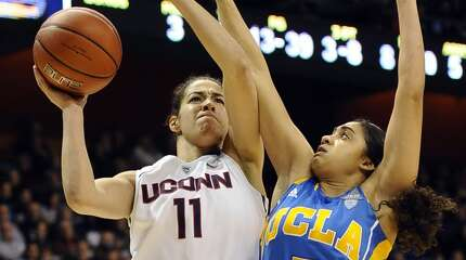 Connecticut's Kia Nurse shoots as UCLA's Recee' Caldwell, right, defends during the second half of an NCAA college basketball game, Sunday, Dec. 21, 2014, in Uncasville, Conn. Connecticut won 86-50.  (AP Photo/Jessica Hill)