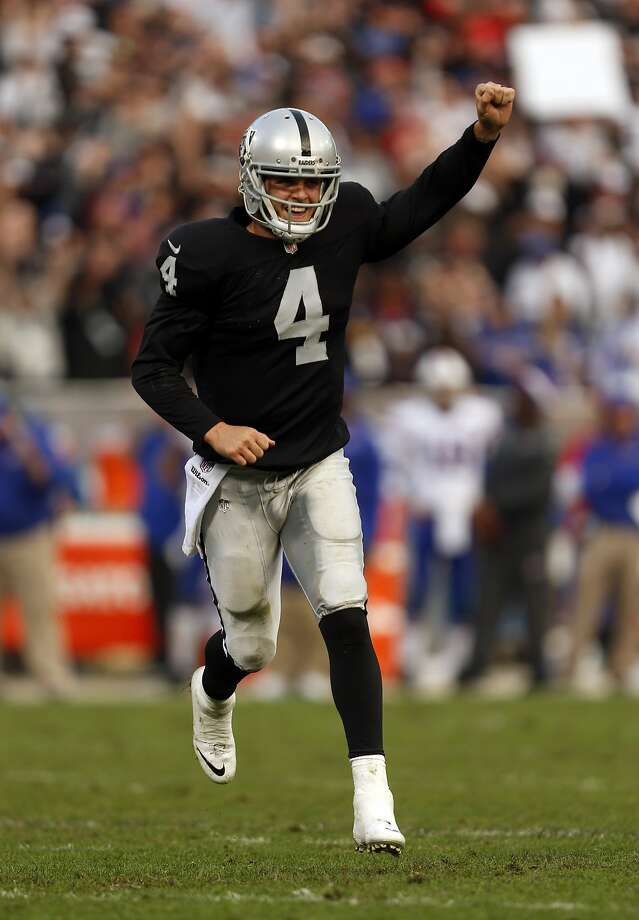 Oakland Raiders' Derek Carr celebrates his 4th quarter touchdown pass to Jamize Olawale during Raiders' 26-24 win over the Buffalo Bills during NFL game at O.co Coliseum in Oakland, Calif., on Sunday, December 21, 2014. Photo: Scott Strazzante, The Chronicle