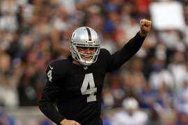 Raiders quarterback Derek Carr celebrates a fourth-quarter touchdown pass to Jamize Olawale.