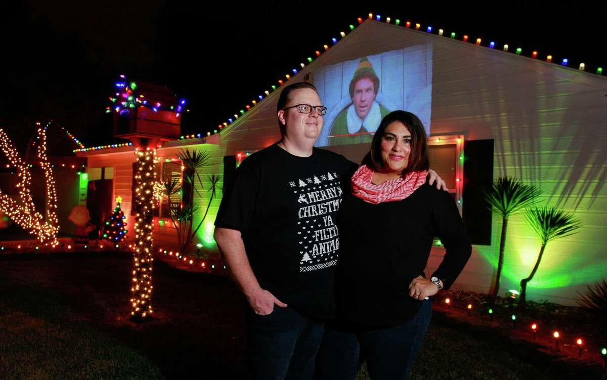 """Matt and Rosie Davis have decorated their house this year with a movie projector that shows Christmas films, like """"Elf."""""""