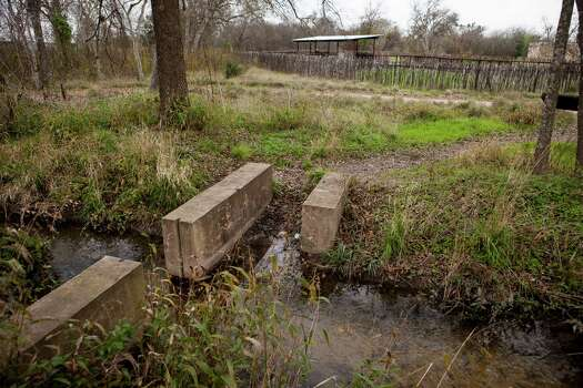 The San Juan Acequia includes rebuilt irrigation diversion locks. Photo: Spencer Selvidge /For The San Antonio Express-News / Copyright 2014, Spencer Selvidge for the San Antonio Express-News