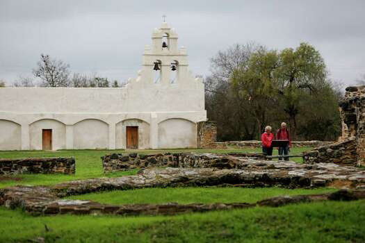 A couple looking at the unfinished Spanish-build church at Mission San Juan, located in south San Antonio in Missions National Historic Park on Dec. 21st, 2014. Photo: Spencer Selvidge For The San Ant / Spencer Selvidge / Copyright 2014, Spencer Selvidge for the San Antonio Express-News