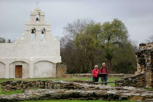 A couple looking at the unfinished Spanish-build church at Mission San Juan, located in south San Antonio in Missions National Historic Park on Dec. 21st, 2014. Photo: Spencer Selvidge /For The San Antonio Express-News / Copyright 2014, Spencer Selvidge for the San Antonio Express-News