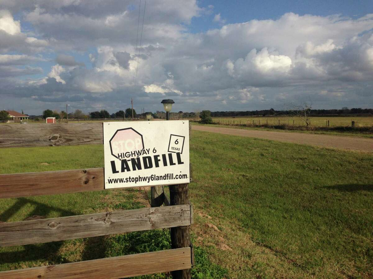 A sign along Kelley Road, off Highway 6, protested the planned landfill in Waller County. A commissioner on Wednesday declared the project