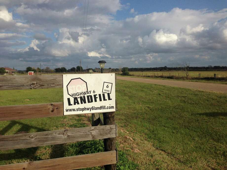 "A sign along Kelley Road, off Highway 6, protested the planned landfill in Waller County. A commissioner on Wednesday declared the project ""dead."" / reporter"