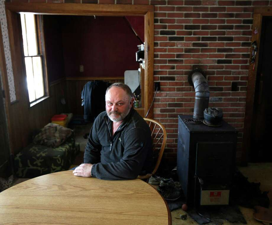 FILE - This Feb. 14, 2013 file photo shows David Johnson posing in the kitchen of his home at his family's Apple Hills Farm in Chenango, N.Y.  While environmental groups are doing a victory dance over New York's decision to ban fracking, farmers such as apple grower David Johnson are grieving for dashed hopes and dreams. (AP Photo/Mike Groll, file) ORG XMIT: NY108 Photo: Mike Groll / AP