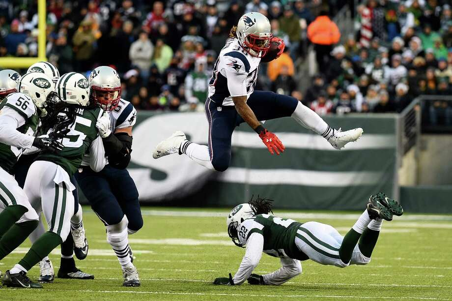 EAST RUTHERFORD, NJ - DECEMBER 21: Running back Brandon Bolden #38 of the New England Patriots jumps over cornerback Marcus Williams #22 of the New York Jets in the fourth quarter during a game at MetLife Stadium on December 21, 2014 in East Rutherford, New Jersey.  (Photo by Alex Goodlett/Getty Images) ORG XMIT: 507869613 Photo: Alex Goodlett / 2014 Getty Images