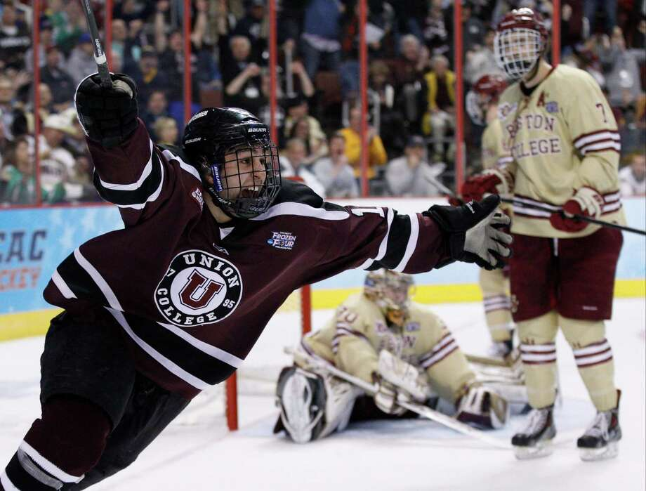 Union's Daniel Ciampini, left, reacts to his goal on Boston College's Thatcher Demko, center, with Isaac MacLeod, right, beside Demko during the second period of an NCAA men's college hockey Frozen Four tournament semfinal, Thursday, April 10, 2014, in Philadelphia. (AP Photo/Chris Szagola) ORG XMIT: PACS112 Photo: Chris Szagola / FR170982 AP