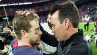 Texans quarterback Case Keenum (7) and Ravens offensive coordinator Gary Kubiak embrace after the game, which was a homecoming of sorts for both men Sunday.
