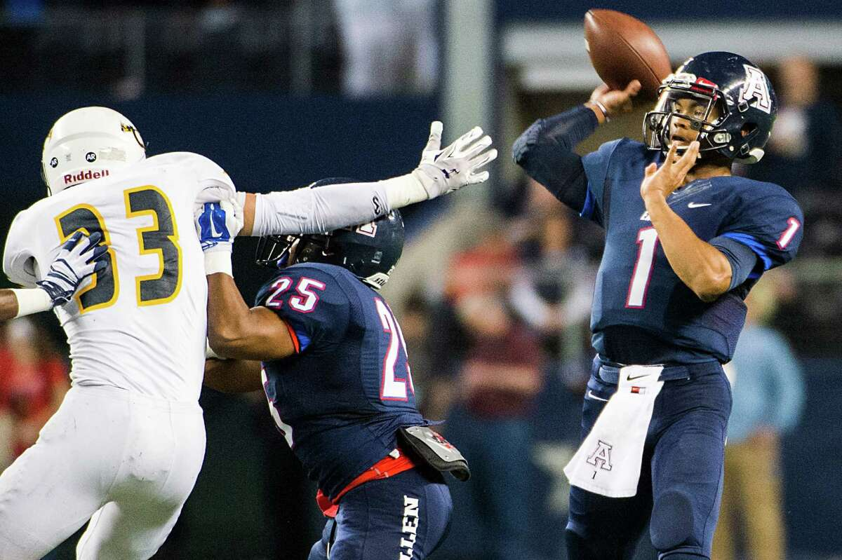 Allen quarterback Kyler Murray (1) throws a pass under pressure from Cypress Ranch linebacker Brayden Stringer (33) during the first half of the Class 6A Division I state football title game at AT&T Stadium Saturday, Dec. 20, 2014, in Arlington. ( Smiley N. Pool / Houston Chronicle )