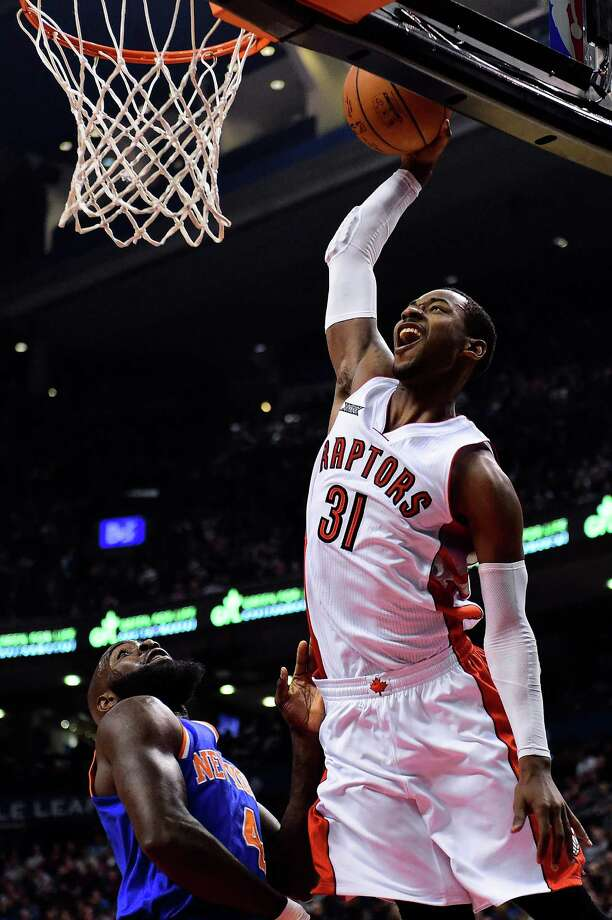 Toronto Raptors Terrence Ross dunks during first half of an NBA basketball game against the New York Knicks in Toronto, Sunday, Dec. 21, 2014. (AP Photo/The Canadian Press, Frank Gunn) ORG XMIT: FNG201 Photo: Frank Gunn / The Canadian Press