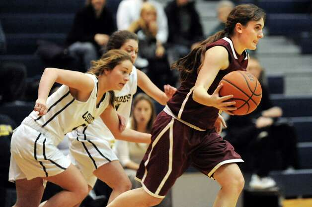 Fonda's Emily Parslow, right, takes control of the ball during their basketball game against Cohoes on Thursday Dec. 18, 2014, at Cohoes High in Cohoes, N.Y. (Cindy Schultz / Times Union) Photo: Cindy Schultz / 00029920A