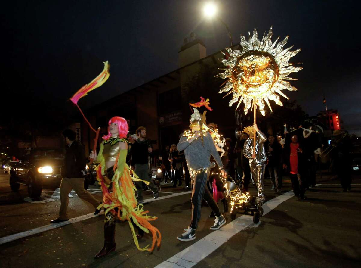 Led by the T Sisters, a group paraded down Bancroft Way on their way to the new site. The UC Berkeley Art Museum is closing its doors on Bancroft Way and held a ceremony Sunday December 21, 2014. They will reopen late next year at a new sits on Oxford and Center Streets.