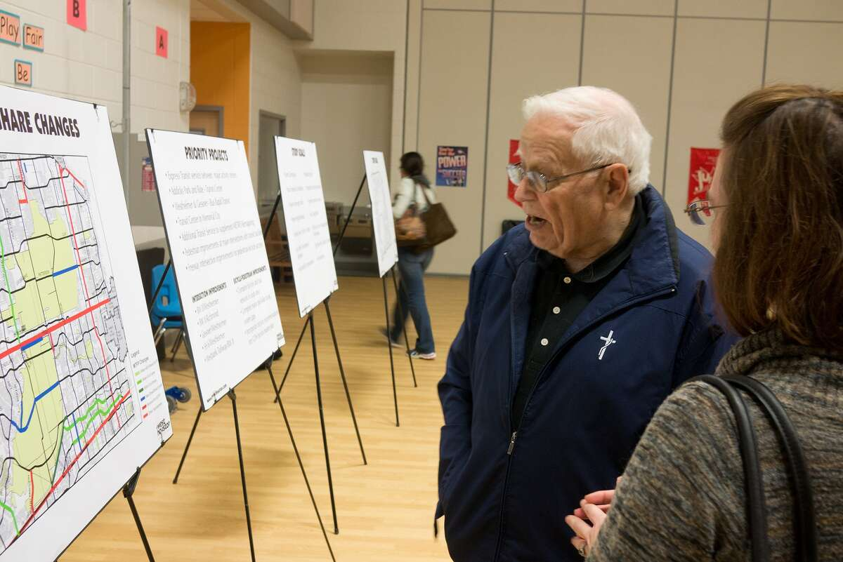 Dale Steffes, 77082, reviews a map of proposed changes during an H-GAC public comment meeting at Wolfe Elementary School. Photo By R. Clayton McKee