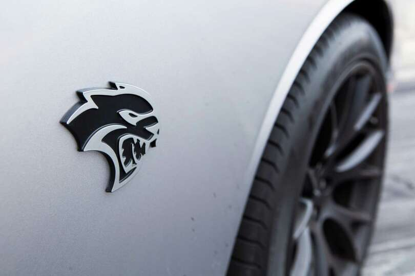Nissan Altima For Sale By Owner View of the 2015 Dodge Challenger SRT Hellcat logo on the ...