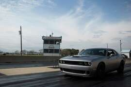 A 2015 Dodge Challenger SRT Hellcat is tested at the Hennessey Performance raceway. The Hellcat has 707 horse power but is also equipped with the features of  comfort and luxury for a daily use. Wednesday, December 17, 2014, in Sealy.