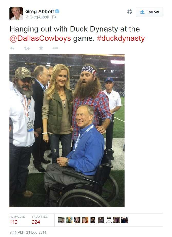 """Governor-elect Greb Abbott spent some time with stars of """"Duck Dynasty"""" at a Dallas Cowboys game. Photo: Twitter"""