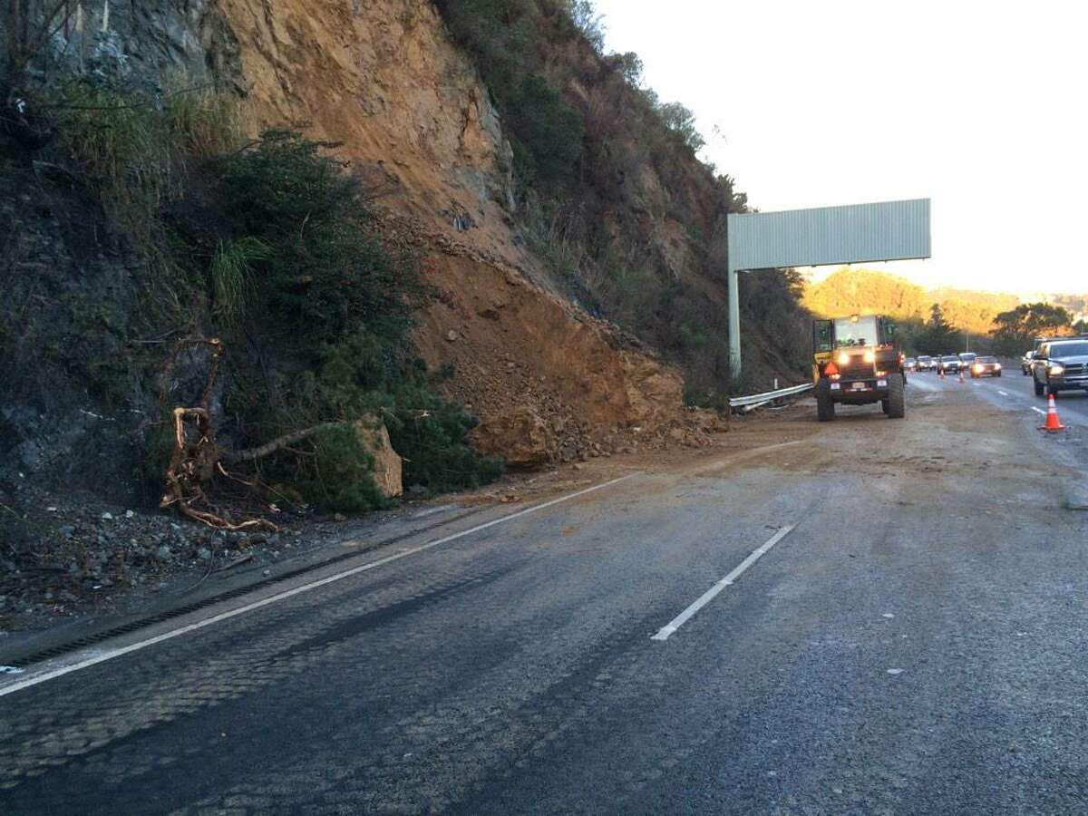 Caltrans crews break up pieces of debris left over from a landslide that spilled into southbound lanes of Highway 101 in Sausalito Monday morning.