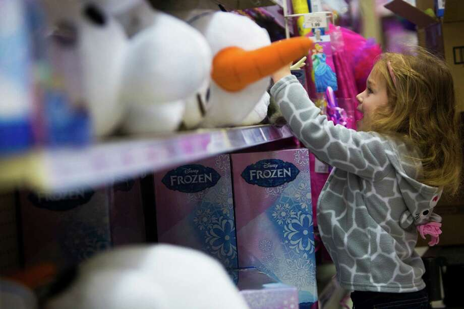 The majority of shoppers have already begun hunting for holiday gifts -- more than any in past years, according to a National Retail Federation survey. Olivia Himes, 3, searches among Frozen merchandise on Black Friday at Toys R Us in Houston, Friday, Nov. 28, 2014. ( Marie D. De Jesus / Houston Chronicle ) Photo: Marie D. De Jesus, File  / © 2014 Houston Chronicle