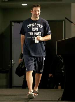Tony Romo wears gym shorts a tee shirt and flip flops as he arrives to a post game interview after their win against the Indianapolis Colts. Photo: Brandon Wade /Associated Press / FR168019 AP