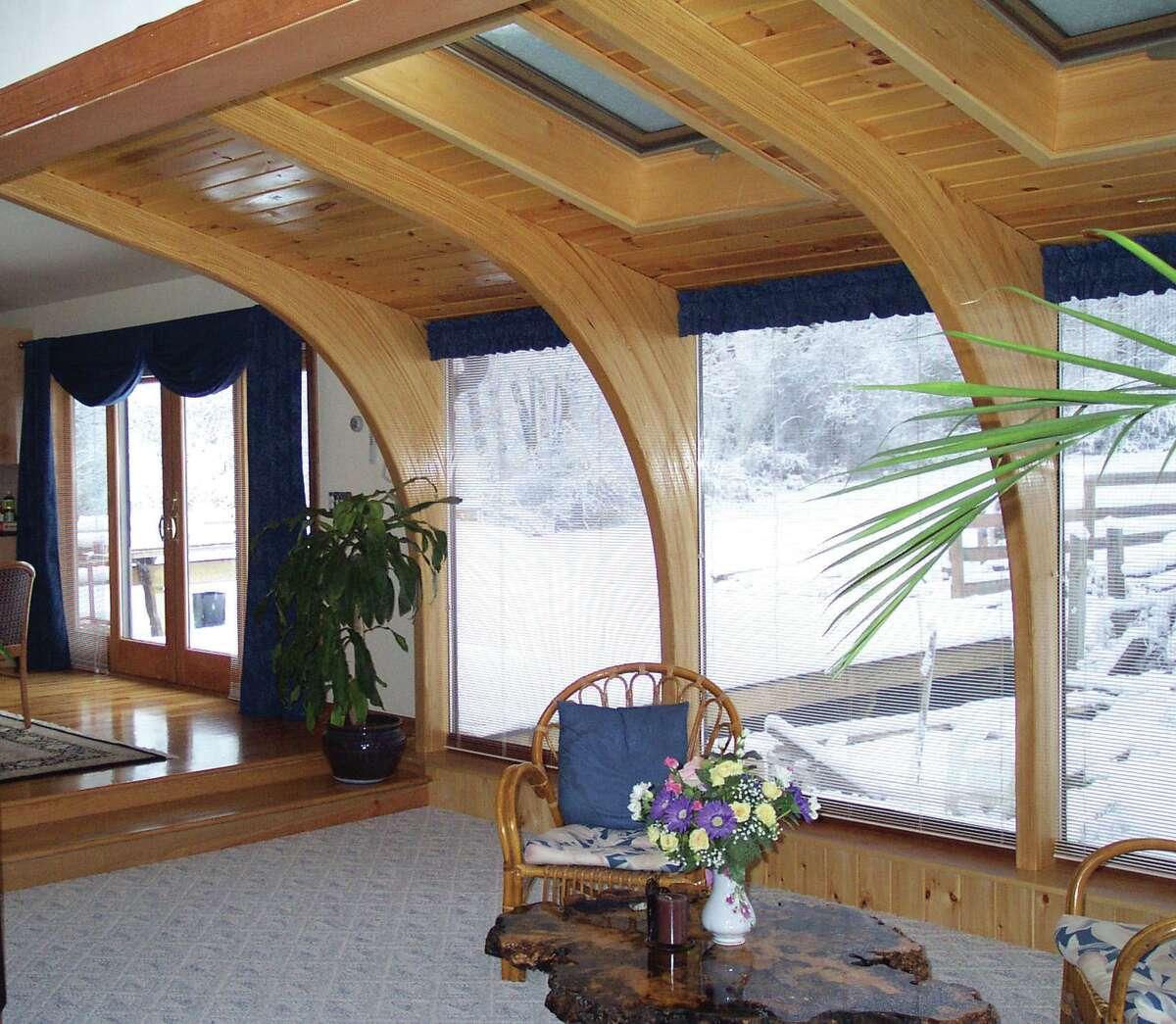 A Tudor Arch style sunroom from SunRoomLiving, LLC. Visit web site.