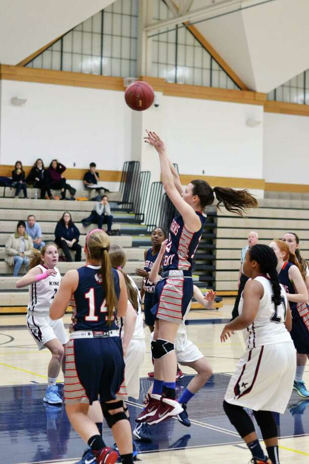 GFA senior Daly Naughton, center, pulls up for a jump shot in GFA's bout with FAA rival King. King won 41-31. Photo: Contributed Photo / Westport News Contributed