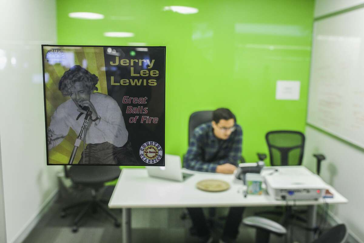 An employee at Udemy sits in the Jerry Lee Lewis, Great balls of Fire office at the new Udemy office space in San Francisco on November 25th 2014. Each conference room and office space at Udemy is themed for a different karaoke song.