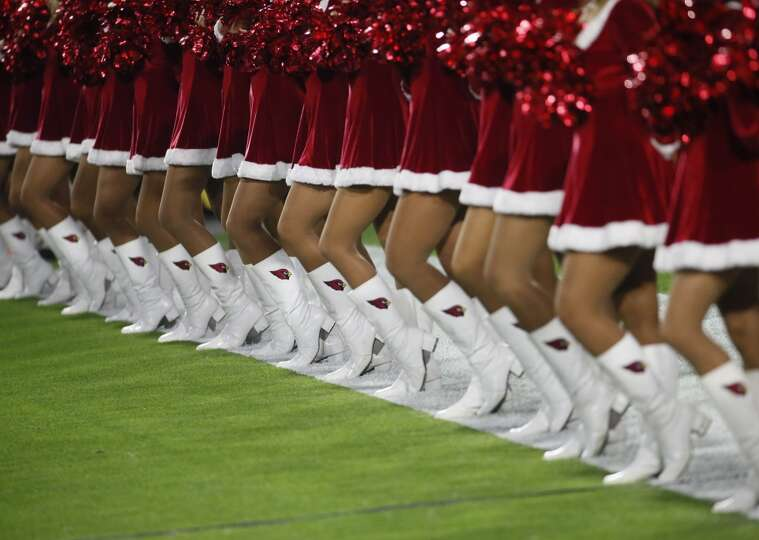 The Arizona Cardinals cheerleaders perform prior to an NFL football game against the Seattle Seahawk