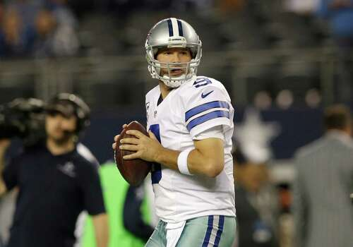 Dallas Cowboys quarterback Tony Romo (9) prepares to pass during warm ups before an NFL football game against the Indianapolis Colts, Sunday, Dec. 21, 2014, in Arlington, Texas. (AP Photo/Tim Sharp) Photo: Tim Sharp, Associated Press / FR62992 AP