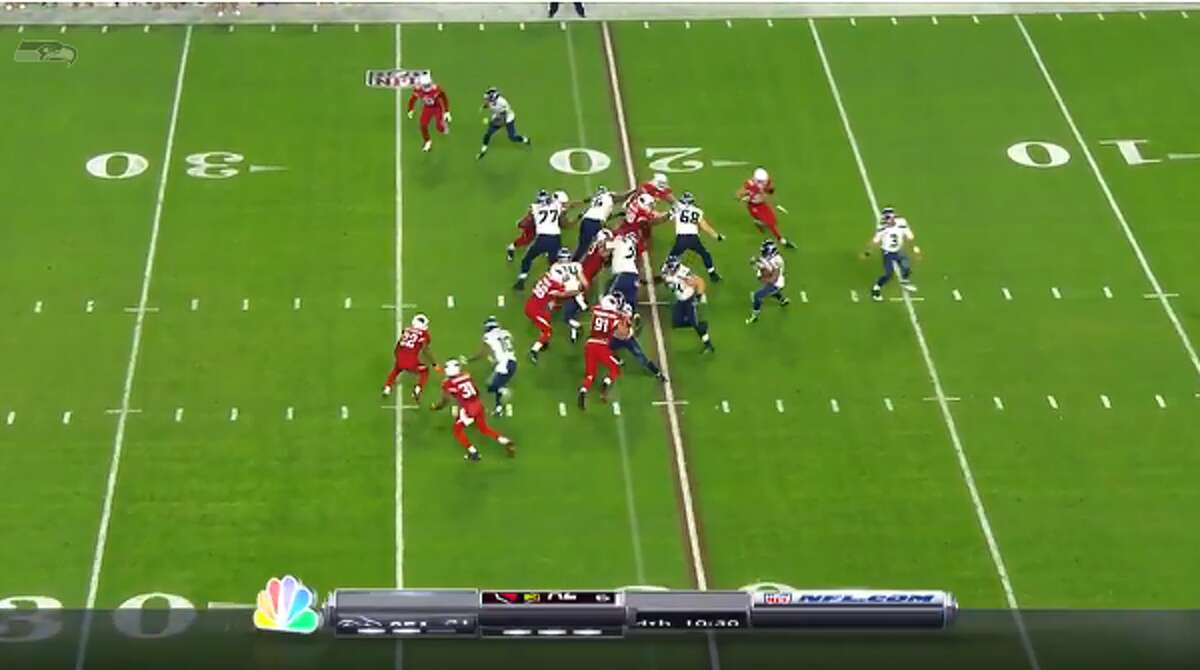 Lynch takes the handoff from Russell Wilson and hits the hole between left tackle Alvin Bailey and left guard James Carpenter, following tight end Cooper Helfet and pulling right guard J.R. Sweezy.