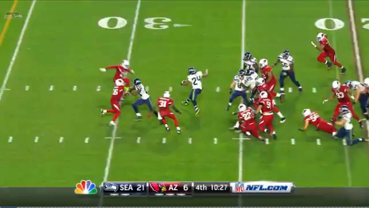 Now past the first line of defense, Lynch jumps forward before planting hard and cutting to his right against Arizona cornerback Patrick Peterson, who had overpursued from his left corner spot.