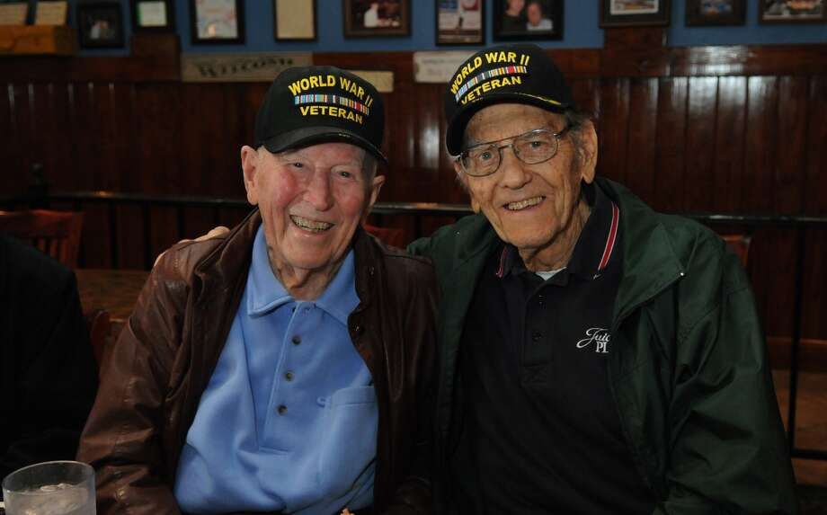 Humble residents Clif Currin, right, and fellow WWII veteran Andy Ferguson work with Kilroy's Krew on community outreach and education. Photo: Jerry Baker, Freelance