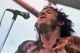 Singer Joe Cocker performs at the Woodstock Music and Art Fair in Bethel, N.Y. in Aug., 1969.