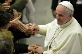 Pope Francis greets the crowd at his audience with Vatican employees after his Christmas speech.