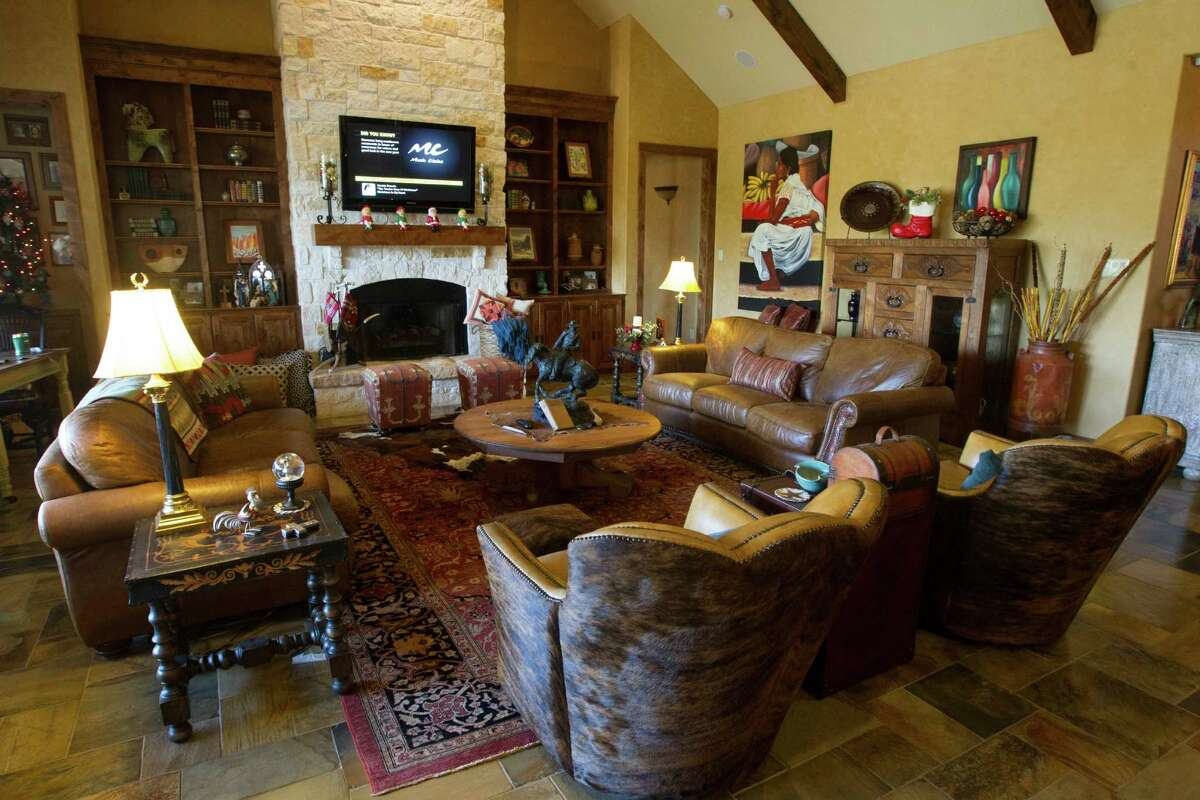 Leather furniture, Western art and animal skins set the tone for Kim and David Williams's home in Fulshear, which reflects the couple's fondness for ranch style.