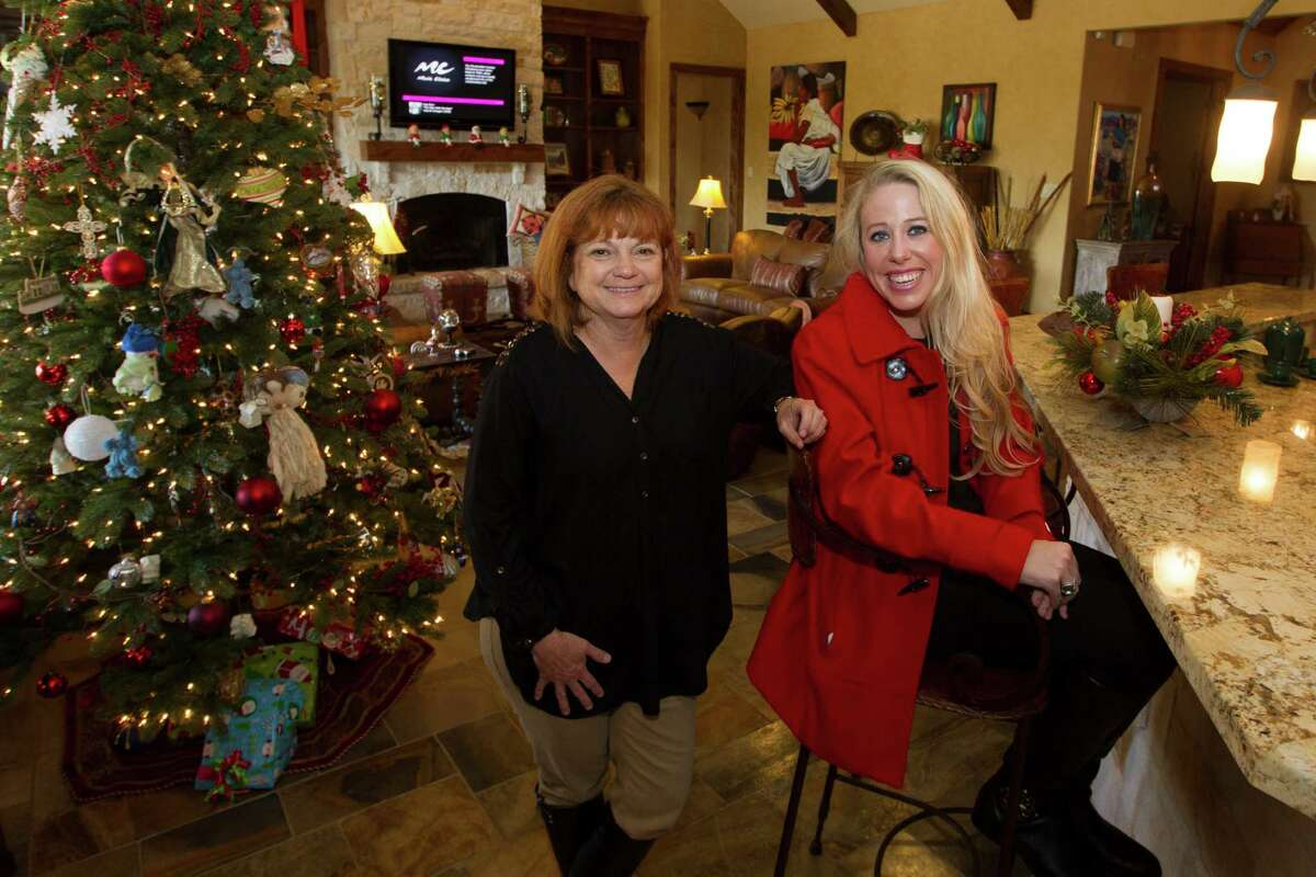 """Kim Williams, left, hired designer Ashton Morgan to give her Fulshear home a Texas ranch style """"with a twist."""""""