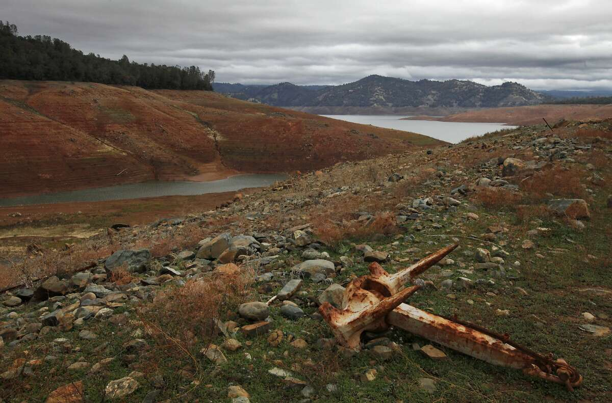 """An old rusted anchor sits above the low water line on the east side of the Lake Oroville dam Nov. 29, 2014 in Oroville, Calif. Despite recent rainfall, California's second largest reservoir is near the 1977 historic low at 26 percent of capacity. """"This has been quite the progression,"""" said longtime resident Sharon Smith, who has been walking the dam since she moved to the area in 1997. """"It seems like it's happening so fast,"""" she said."""