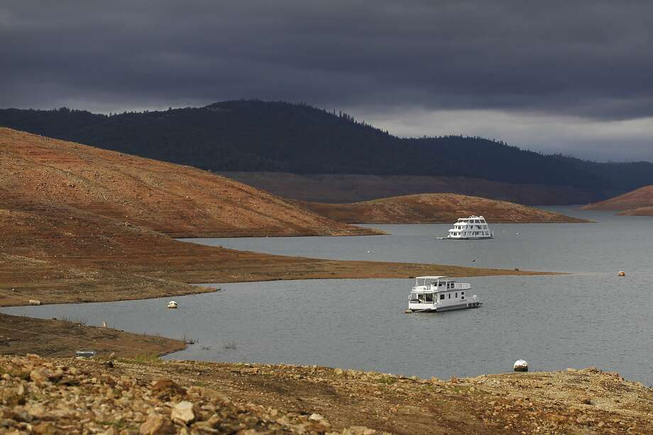 House boats sit idle in the low water of Lake Oroville Nov. 29, 2014 in Oroville, Calif. Figures released Tuesday, Jan. 6, 2014, by the State Water Resources Control Board show California residents used 9.8 percent less water in November 2014 than in the same month in 2013. Photo: Leah Millis, The Chronicle