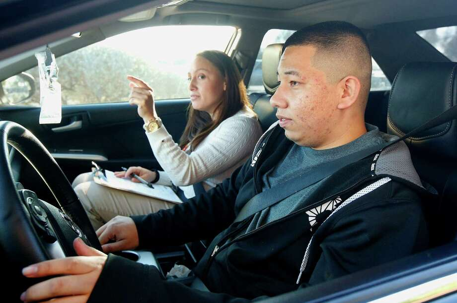 Ramon Maldonado of Phoenix begins his driving test. He also passed his written test and got a license. Photo: Ross D. Franklin / Associated Press / AP