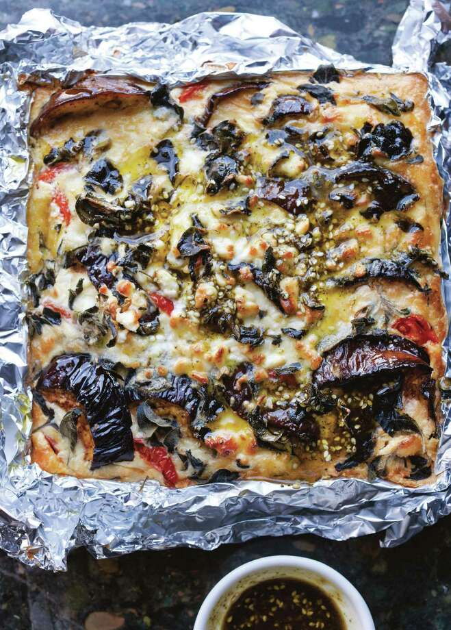 "In the age of Yotam Ottolenghi cookbooks, daring home chefs dive into his dishes, such as this Eggplant Cheesecake recipe from ""Plenty More: Vibrant Vegetable Cooking From London's Ottolenghi."" Photo: Jonathan Lovekin / ONLINE_YES"