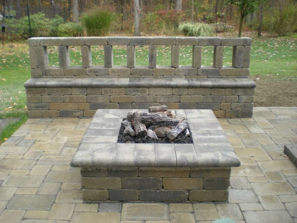Fire pit built by Paul Vasto & Son Landscape Contractor. Visit web site.