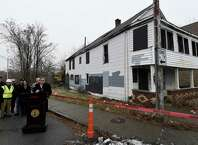 Mayor Gary McCarthy kicked off the start of demolition of 1150 Cutler St. Monday morning, Dec. 22, 2014, in Schenectady, N.Y. The home was damaged beyond repair by fire and was demolished as part of the $7 million initiative to rebuild Schenectady.   (Skip Dickstein/Times Union)