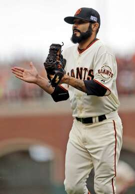 San Francisco Giants relief pitcher Sergio Romo celebrates the end of the the top of the 10th inning of Game 3 of the National League baseball championship series against the St. Louis Cardinals, Tuesday, Oct. 14, 2014, in San Francisco. (AP Photo/Jeff Roberson)