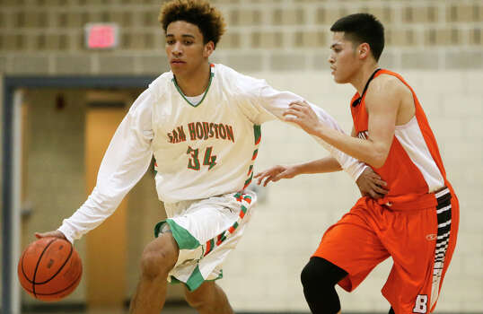Sam Houston's Robert Christian (left) brings the ball upcourt with Burbank's Juan Castillo defending during a game at the Lanier Alumni Center on Dec. 9, 2014. Burbank beat the Hurricanes 60-40. Photo: Marvin Pfeiffer /San Antonio Express-News / Express-News 2014