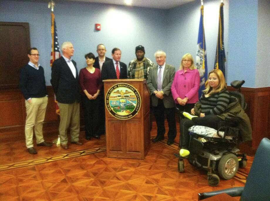 Greenwich resident Joe Kaliko at a ceremony to honor the work of his nonprofit, The Needs Clearing House. Mayor Bill Finch, second from left,  Donna Romano of Bridgeport Rescue Mission,   Senator Blumenthal , Charles Fuller formerly homeless, who the organization placed at Goodwill's Wahlstrom  House, honoree  Kaliko, his wife, Mary Gai, who also is on NCH board, and Rosa Gonzales, one of the group's clients. Photo: Contributed Photo / Greenwich Citizen
