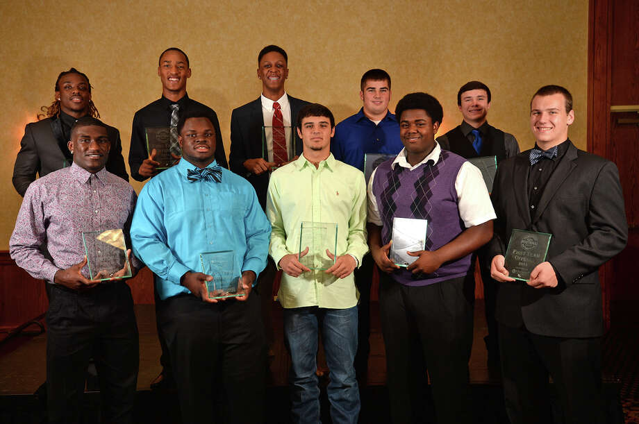 Back row from left, Demarcus Smith, Carnell Seals, Keith Corbin, Ty Tamplin, Kaleb Sparks, Corey Dauphine, Vernon Samuels, Sage Seay, Marvis Brown and Dustin Burns at the Beaumont Enterprise Super Gold Banquet on Monday.   Photo taken Monday, December 15, 2014  Guiseppe Barranco/The Enterprise Photo: Guiseppe Barranco, Photo Editor