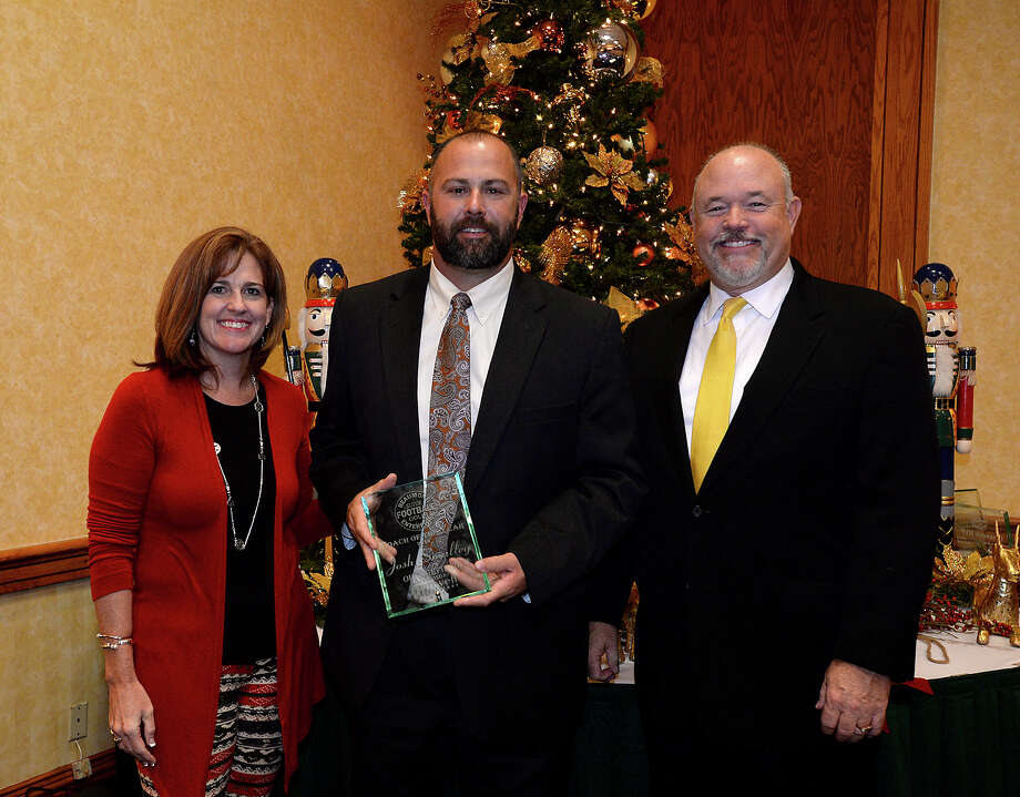 Football Coach of the Year Josh Smalley of Orangefield poses with Howell Furniture's Shawn Hanley and Mark Adkins, Publisher of The Beaumont Enterprise, at the Super Gold award ceremony for the area's volleyball and football star athletes at the Elegante Monday night. Photo taken Monday, December 15, 2014 Kim Brent/The Enterprise Photo: Kim Brent / Beaumont Enterprise