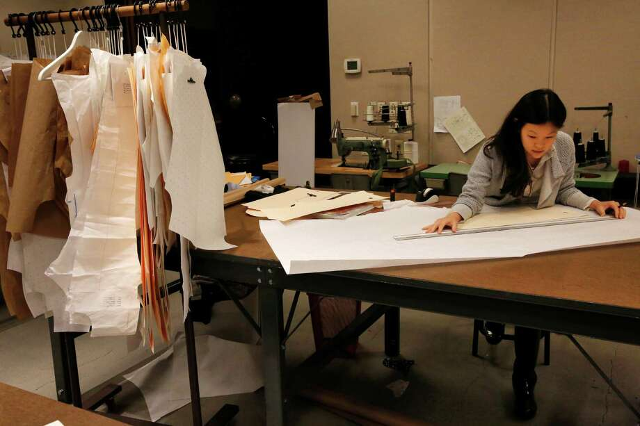 Anna Min works on designs for her Min Edition label last week at Fashion Incubator San Francisco, which is in a former Macy's boardroom on the top floor of the Macy's Men's Store building on O'Farrell Street. Photo: Leah Millis / The Chronicle / ONLINE_YES