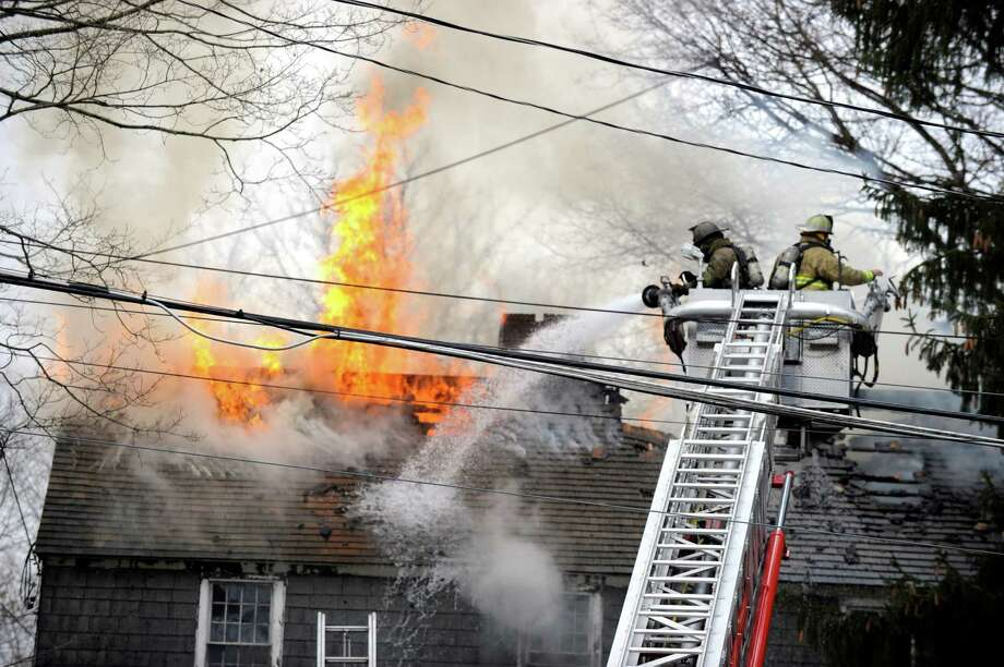 Bethel and Stony Hill fire departments responded to a fire at a home on Blackman Avenue in Bethel, Conn., Monday, Dec. 22, 2014. Photo: Carol Kaliff / The News-Times